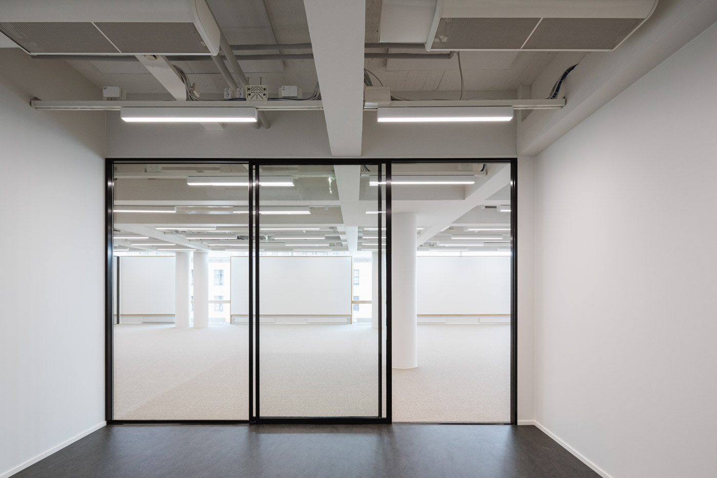 The new office of Verstas Architects, designed by ourselves. Minimalist glass wall.