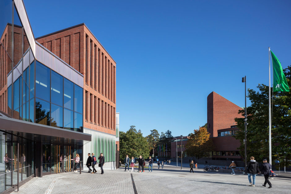 The new square and public space in front of the Aalto University Väre Building for The School of Art, Design and Architecture, designed by Verstas Architects. Alvar Aalto's old main building in the background.