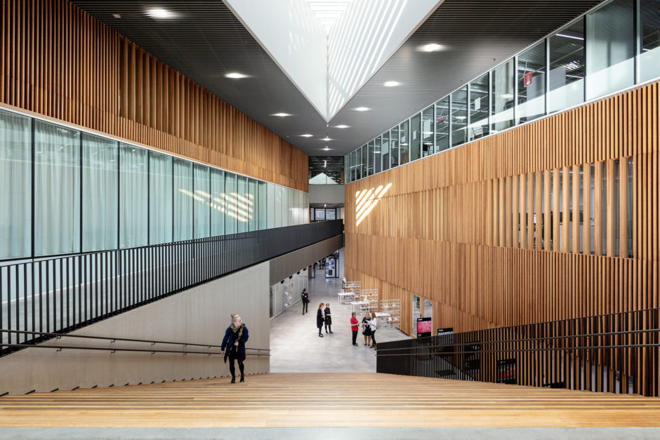 The main lobby with wooden surfaces in the Aalto University Väre Building for The School of Art, Design and Architecture, designed by Verstas Architects.