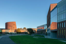 Facade of the Aalto University Väre Building for The School of Art, Design and Architecture, designed by Verstas Architects. Alvar Aalto's iconic main building in the background.