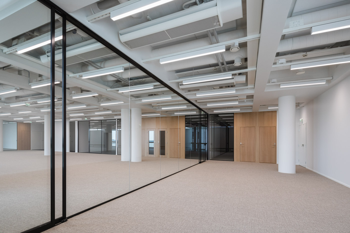 The new office of Verstas Architects, designed by ourselves. Oak doors, minimalist glass walls.
